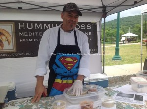 James Matar, the Hummus Boss, with his many culinary creations. Photo by Jennifer Jean Miller.