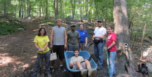 Group photo at the conservation project (Katie Rozek, Christopher Rozek, Marcus Hobson, Kathryn Livesey, Zach Button, Sarah Button and Stephen Rozek in the wheelbarrow). Image courtesy of Venture Crew 276.