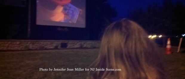 A youngster watches The Lego Movie on the jumbo screen in the park. Photo by Jennifer Jean Miller.