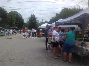 Visitors to the Blairstown Farmers' Market visit Sugh's Southern Sweets and other vendors. Photo by Jennifer Jean Miller.