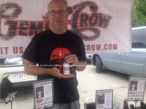 Dov Teva poses with one of his Gemini Crow sauces. Photo by Jennifer Jean Miller.