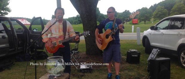 Non-Stop Denny and Kevin McNeel provided musical entertainment at the farmers market. Photo by Jennifer Jean Miller.