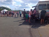 Attendees wait at the Philly Curbside Creamery truck at the festival. Photo by Jennifer Jean Miller.