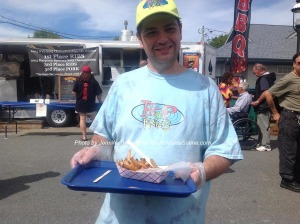 Justin Rod passing out samples for Hop Fries. Photo by Jennifer Jean Miller.