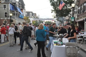 Attendees arrive before dark and check out the offerings on Spring Street. Photo by Jennifer Jean Miller.
