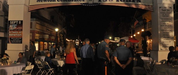 Visitors to A Taste of Newton enter through the archway to the festivities on Spring Street. Photo by Jennifer Jean Miller.