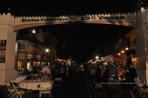 The moon shines over Spring Street onto A Taste of Newton. Photo by Jennifer Jean Miller.