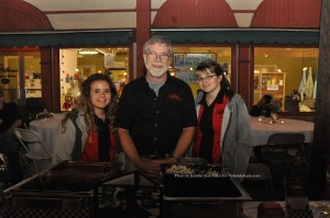 Representatives from The Chatterbox Drive-In offered  Cranberry Chicken Salad, Pulled Barbecue Pork, and Baked Beans. The restaurant's owner Don Hall (center) is assisted by Jenna Winkeleman (left) and Stephanie Cooke (right). Photo by Jennifer Jean Miller.