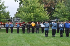 Members of local police departments and explorers stand at attention. Photo by Jennifer Jean Miller.