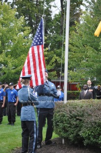 Members of the Sussex County Explorers raise the flag. Photo by Jennifer Jean Miller.
