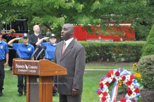 Retired Police Officer Arthur Sibblies sings the National Anthem. Photo by Jennifer Jean Miller.