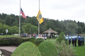 The crowd at attention during Taps. Photo by Jennifer Jean Miller.