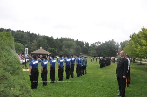 Police, firefighters and explorers during Taps. Photo by Jennifer Jean Miller.