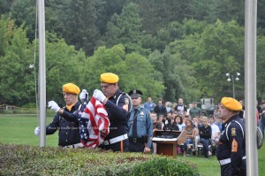 Members of VFW Post 10152 remove the flag from the pole. Photo by Jennifer Jean Miller.