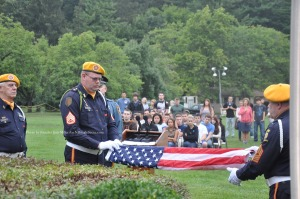 Members of VFW Post 10152 ceremoniously fold the flag. Photo by Jennifer Jean Miller.