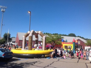 An array of bouncy rides were at the festival entrance. Photo by Jennifer Jean Miller.
