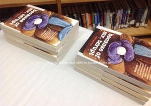 Books lined up at the signing event. Photo by Jennifer Jean Miller.