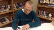 Author Rob Buyea signs a book during the breakfast at Halsted Middle School. Photo by Jennifer Jean Miller.