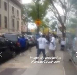 One protestor redirects another in this screenshot from the video. Image provided.