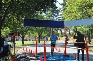 Jack Montgomery crosses the finish line. Photo by Jennifer Jean Miller.