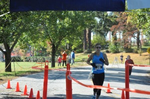Tina Santos was third in the 5K race overall and first for the women. Photo by Jennifer Jean Miller.