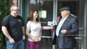 Keri Marino, owner of PEARLL Yoga for the Soul, opens the doors for her business with husband Tony (left) and Franklin Borough Mayor Paul Crowley (right). Photo by Jennifer Jean Miller.