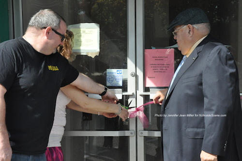 Cutting the ribbon for PEARLL Yoga for the Soul. Photo by Jennifer Jean Miller.
