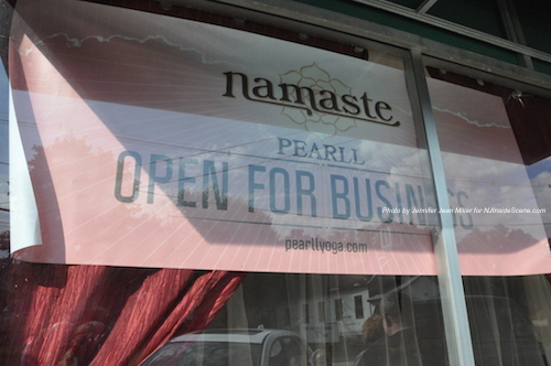 The welcoming sign in the front window of PEARLL Yoga for the Soul. Photo by Jennifer Jean Miller.