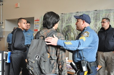 Newton Police Sergeant Frank Philhower (right) speaks to two Sussex County Community College students during the