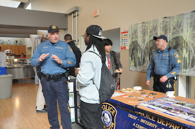 Officer Ken Teets (left) and Sergeant Frank Philhower (right) speak to students. Photo by Jennifer Jean Miller.