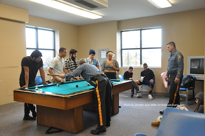Officers Shawn Burke and Thomas Tosti shoot some pool with Sussex County Community College students at the Coffee with a Cop on Campus event. Photo by Jennifer Jean Miller.