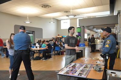Newton Police Officer Ken Teets (left) and Sergeant Frank Philhower (right) speak to attendees at the Coffee with a Cop on Campus at Sussex County Community College. Photo by Jennifer Jean Miller.