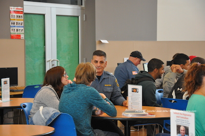 Officer Tom Tosti (left) and Ken Teets (right) mingle with students during the Coffee with a Cop on Campus event. Photo by Jennifer Jean Miller.