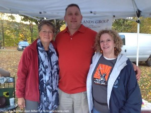Three members of the Sierra Club from left to right: Tina Novak, Edgar Shepherd, and chair Susan Williams. Photo by Jennifer Jean Miller.