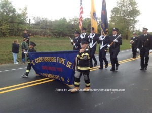 The Ogdensburg Fire Department leads off with two young participants holding the banner. Photo by Jennifer Jean Miller.