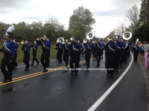 The clouds begin to break as the marching band parades by. Photo by Jennifer Jean Miller.