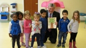Senator Steven Oroho celebrates his love of reading with children at the Little Sprouts Early Learning Center.