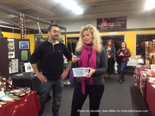 CKO Franklin Public Relations Manager Marc Girardi (left) and Darlene Pallay of CKO Franklin and Augusta (right) draw for the raffle of a CKO membership and CKO gear. Photo by Jennifer Jean Miller.