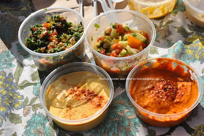 Tabouli and Avocado Salad (top, left to right) and Pumpkin Hummus and Pepper Ganouj (bottom, left to right), were some of the Hummus Boss' items at the market. Photo by Jennifer Jean Miller.