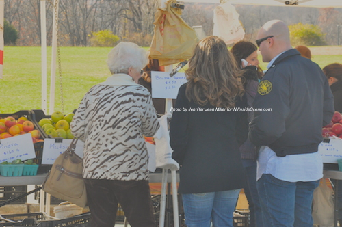 Attendees purchase fruit at the Race Farms booth at the Winter Farmers' Market at Sparta. Photo by Jennifer Jean Miller.
