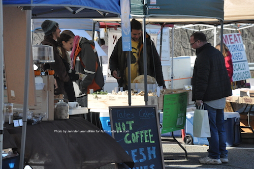 Tate's Cakes came to the market with baked goods and crossed hot coffee off of the menu as the day dwindled down, and DiningWild LLC toted exotic mushrooms and wild greens. Photo by Jennifer Jean Miller.