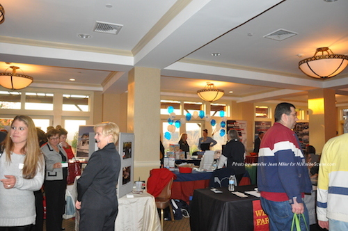 Attendees visit with businesses in the lower level. Photo by Jennifer Jean Miller.