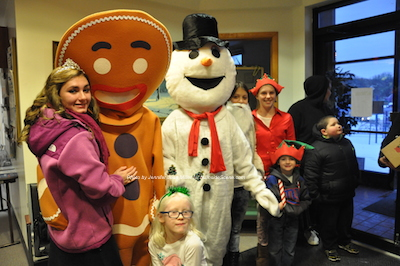 Miss Franklin poses with a Gingerbread Man, Frosty the Snowman and a group of children. Photo by Jennifer Jean Miller.