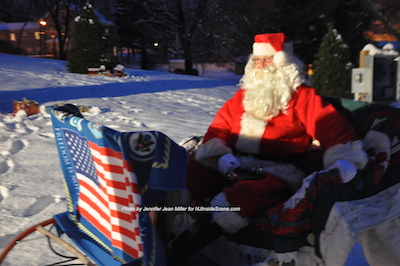 Santa relaxes in his sleigh. Photo by Jennifer Jean Miller.