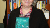 "Assistant Professor, Jean LeBlanc with her new book ""Skating in Concord."" Photo courtesy of SCCC."