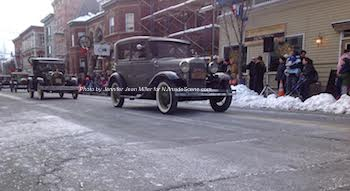 Model A's drive down Spring Street, as they did in days gone by. Photo by Jennifer Jean Miller.