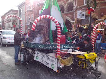 "Snow falls on the ""Christmas Throughout the Ages"" float. Photo by Jennifer Jean Miller."
