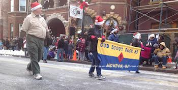 Cub Scouts donning Santa hats were part of the parade. Photo by Jennifer Jean Miller.