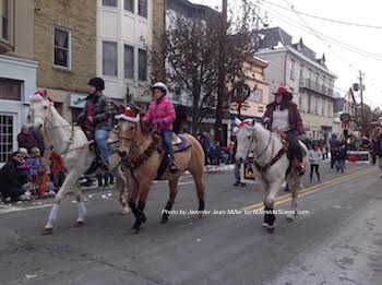 Horses trot along Spring Street. Photo by Jennifer Jean Miller.