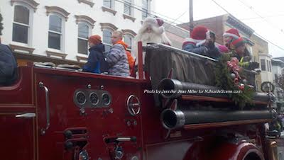 Santa surveys the crowd on Spring Street. Photo by Jennifer Jean Miller.